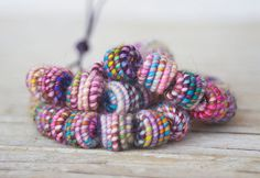 Handmade Copper-Fiber Bead.  The Thread is hand dyed.  Color: colormix, multicolor......  No glue is used.    Twenty (20) Fiber and Wire Beads,