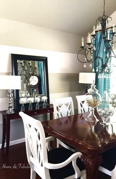 Adding a mirror and crystal lamp from homegoods gives this empty wall a big transformation in my dining room. #homegoodshappy (sponsored pin)