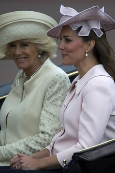 The Duchess of Cambridge (R) and The Duchess of Cornwall, ride in a carriage on their way back to Buckingham Palace following the Queen's Birthday Parade, 'Trooping the Colour,' at Horse Guards Parade in London on June 15, 2013.