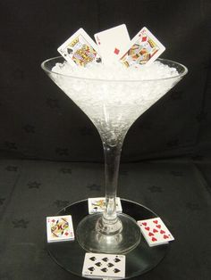 James Bond Themed Party Martini vase with clear ice gel with playing cards inside. Placed on top of Round Mirror with playing cards scattered. James Bond Wedding, James Bond Party, James Bond Theme, Casino Theme Parties, Casino Party, Party Themes, Casino Night, Party Ideas, Las Vegas Party