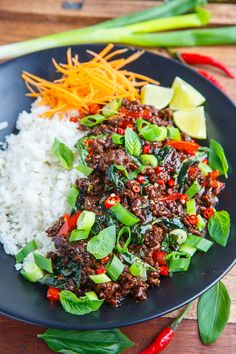 Thai Basil Beef With Ground Beef Shallots Red Pepper Garlic Chiles Fish Sauce Palm Sugar Lime Juice Basil Green Onions Thai Dishes, Beef Dishes, Thai Basil Beef, Thai Basil Recipes, Thai Food Recipes, Fresh Basil Recipes, Thai Beef Salad, Recipes With Fish Sauce, Tasty Thai