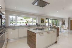 darkish Wood side panels against cashmere coloured kitchen.