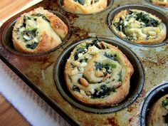 Florentine Rolls with spinach, garlic, onions, Feta, and pine nuts rolled inside pizza crust. House warming party hor d'oeuvres, check!