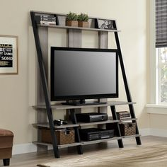 Clean, modern and attractive, this ladder style home entertainment center makes a big impact in any decor. Designed to accommodate flat panel TVs up to 48 inches, this home entertainment center creates a stunning focal point in your living room.