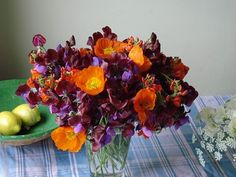 purple and pink Sweetpeas with orange Iceland Poppies and Bean Flowers
