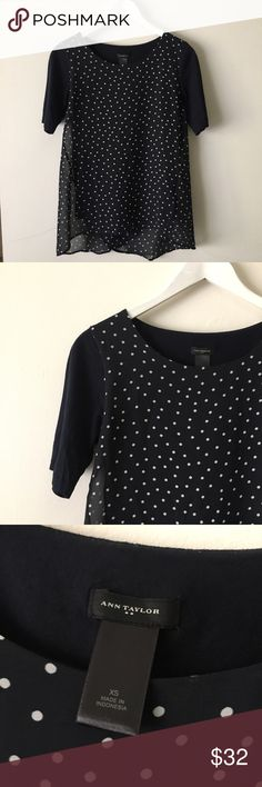 "Ann Taylor Polka Dot Top Absolutely adorable Mixed Media polka dot Tshirt with cross back detail. Sheer polka dot material over a navy short sleeve Tshirt. Polyester/Cotton Blend. Bust: 31"" Shoulder: 14 1/2"" Length 24"" Ann Taylor Tops Blouses"