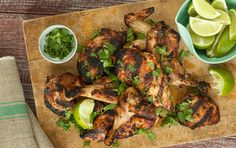 Coconut Milk-Grilled Chicken // Juicy and flavorful, this Thai-inspired grilled chicken is marinated in coconut milk, fresh lime juice and Asian fish sauce.