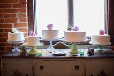 White frosted cakes with different textures/sized rounds. Cake pedestals from garage sales?