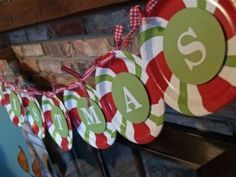 Paper plates, paper, letter stickers and ribbon make the cutest Christmas garland ever!