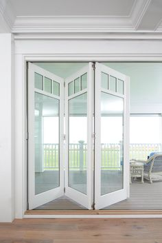 metal barn homes Window and Door Images - Marvin Family of Brands White Bifold Doors, Bifold Barn Doors, Garage Doors, Folding Patio Doors, Metal Barn Homes, Door Images, Interior Barn Doors, Windows And Doors, Glass Door