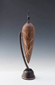 "Out of Africa - Tambootie, black wood and ebony with copper inlay. 14"" tall by Larry Weese Jr."