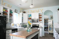 Yellow and teal/blue/turquoise kitchen - i love how cheery it is, and the yellow accents up high on top of the cabinets
