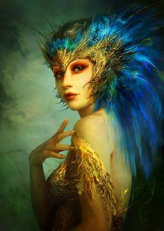 Feather headdress lady. Benita Winckler.