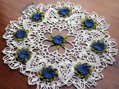 Crochet doily with blue flowers natural colored lace by Draiguna