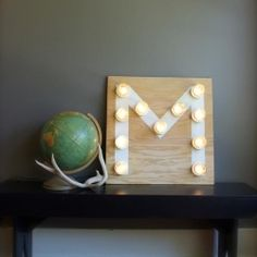 Brighten up your space by making your own Monogram Light using mason jars for lightbulb covers. It's easier then it looks.