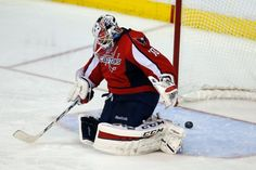 The goal by New York Islanders center Frans Nielsen, from Denmark, gets past Washington Capitals goalie Braden Holtby (70) during the third period of Game 7 in the first round of the NHL hockey Stanley Cup playoffs, Monday, April 27, 2015, in Washington. The Capitals won 2-1, to advance. (AP Photo/Alex Brandon)
