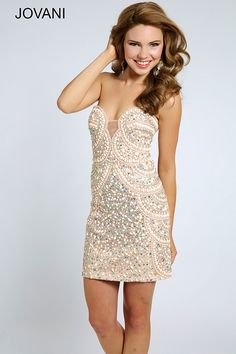 Shine all night in this Jovani 20440 homecoming dress that showcases unique, scalloped beading. The strapless, plunging sweetheart neckline is accented with a sheer panel...