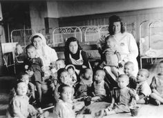 Group of children and nurses in an orphanage that was situated in the ghetto hospital. Kovno, Lithuania, 1941-1943 Anonymous No Longer. Holocaust History Museum. Yad Vashem