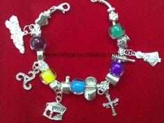 pulsera de asturias con hórreo, trisquel, cruz, mapa de Asturias, manzana, Santina, botella de sidra y vaso, todo en plata
