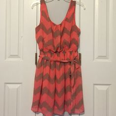 Semi-formal dress Coral and brown tank top style, semi-formal dress. Fully lined with coral and a sheer chevron print overlay. Worn a few times. In great condition! No rips, tears, or stains. Lily Rose Dresses