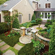 Cottage Garden Courtyard  The cottage garden courtyard ties the orginal home to the addition and has an intimate scale. Partially hidden from the street below, it creates intrigue—only the stone wall, gate, and a few plants can be seen.