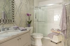 A bathroom in the 2014 Ware Mansion Designer Showroom designed by Karen Viscito. This room features Charleston wallpaper from the 18 Karat II collection.