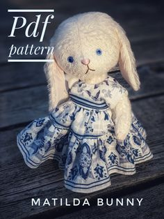 Pdf pattern of Matilda Bunny. Make your very own wee bunny. She is so much fun to make, dress, and pose! This sweet teddy dolly is made of white vintage style mohair, has blue glass eyes, and is fully jointed. This dress was made using the free dress pattern in the sotreasured.com newsletter! xo