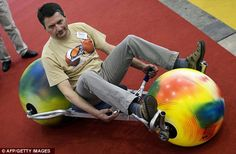 Ball rider: Germany's Ulli Boehme poses with the 'Ball Rider' a new sport and leisure vehicle equipped with large balls as wheels