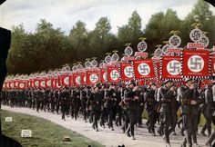 Nuremberg, Germany, 1933, SS Men Marching with Nazi Party Flags Photographs Film and Photo Archive, Yad Vashem All rights reserved
