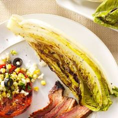 Grilled Romaine Hearts Recipe -Romaine is a great companion for a grilled medium rare steak, but don't leave it on the grill too long, or the leaves may scorch. Romaine Hearts Recipe, Grilled Romaine Hearts, Salad Bar, Soup And Salad, Clean Eating, Healthy Eating, Healthy Foods, Rare Steak, Dinner On A Budget