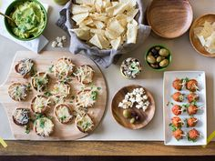 The Spread : What Super Bowl party would be complete without lots and lots of snacking? Keep guests fully satisfied by arranging your entire spread on the coffee table where it