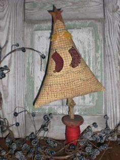 Appliqued Christmas tree on thread bobbin....