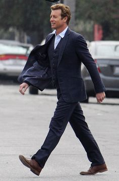 No one wears a three piece suit better than Simon Baker
