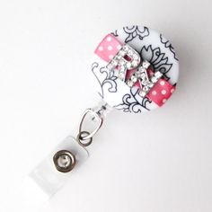 RN Pink Bling Damask - Pretty Badge Reels - Unique Badge Holder - Stylish Name Badge Clip - Personalized Nurse Jewelry - BadgeBlooms. $20.00, via Etsy.