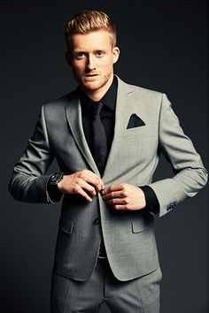 andre schuerrle -Germany... Men's light grey suit with black shirt and black tie.