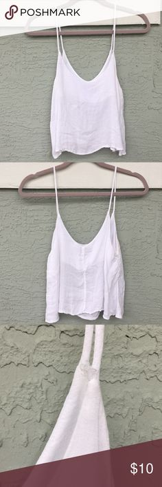 Brandy Melville Top Goes great with a pair of jeans and sandals!  Condition: good with some loose threads 58% cotton 42% viscose Brandy Melville Tops Tank Tops
