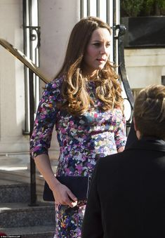No coat: The Duchess was without a coat and chose to brave the cold in nothing more than h...