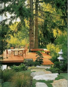 deck cantilevered over slope retaining wall   deck over pond, boulder steps, towering firs, Japanese-y foreground ...