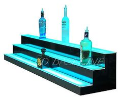 made by putting thin strips of LED under a piece of plexi. LED's have remote with color control for variety. to make, just router out notches in current wood platform. leave permanently for better bar lighting! Bar Shelves, Shelving Display, Floating Shelves, Bottle Display, Back Bar, Garage Bar, Man Cave Bar, Bottle Lights, Liquor Bottles