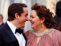 It's Melissa McCarthy by a nose! The Best Supporting Actress nominee and husband Ben Falcone show their off-screen chemistry at the Oscars, where their film Bridesmaids was up for Best Original Screenplay.