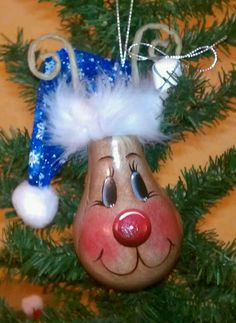 Cool way to recycle old bulbs.....cute Rudolph!
