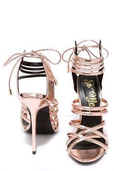 We have been all smiles and sunshine since the Lift Your Spirits Rose Gold Caged Heels came around! Metallic rose gold vegan leather is ultra glam over a strappy peep toe and caged upper. Single lace (with gold aglets) ties above the cutaway heel.