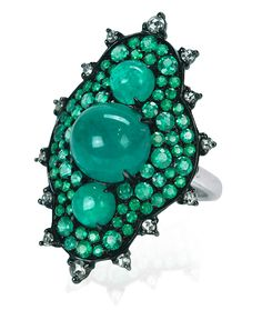 Cellini Jewelers, Nam Cho's This Armor Ring is just that; the perfect blend of fun and sophistication. Wear this piece with blue jeans for an everyday look or cocktail dress for a night out. Brilliant cut emeralds surround 3 cabochon emeralds, s
