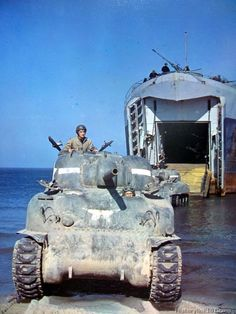 Tank leaves transport while training for amphibious operation during maneuvers for landing in enemy territory during war.