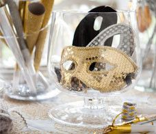 Set the table with vases of New Years Eve party favors to grab