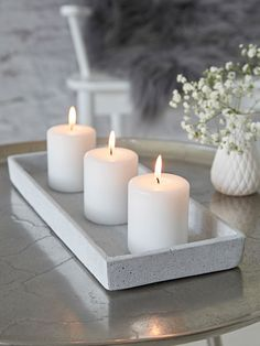 https://www.nordichouse.co.uk/rectangular-concrete-grey-tray-p-2602.html https://www.nordichouse.co.uk/stylish-white-pillar-candles-p-329.html 6x7 candle