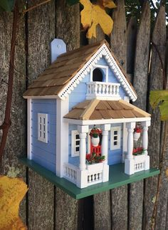 This lovely New Orleans Bird House is rich in detail including a beautiful scalloped red cedar shingled roof and decorative hanging flower pots with red blooms. Large Bird Houses, Wooden Bird Houses, Decorative Bird Houses, Bird Houses Painted, New Orleans, Exterior Grade Plywood, Hanging Flower Pots, Cedar Shingles, Bird House Kits