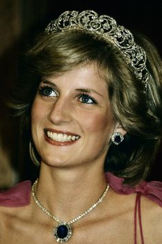 HRH Diana, Princess of Wales attending a State Reception. Diana wears a suite of sapphire and diamond jewelry presented by the Crown Prince of Saudi Arabia for her wedding and the Spencer family tiara. (April 11, 1983) in Brisbane, Queensland, Australia.