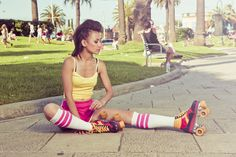 classic retro looks of 80s roller blading girl wearing colourful clothing in St kilda - By Daniel Brokstad