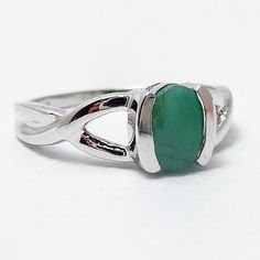 My Irish Eyes are Smilin' ~  Sterling Silver Natural .85ct Emerald Solitaire Ring